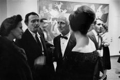 Salvador Dali, Gala and ? at opening of a Retrospective of Max Ernst works here in Museum of Modern Art, NY. Photo by Dennis Stock