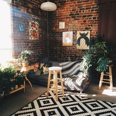 Moon to Moon: Eclectic Sitting Rooms. Art on brick works well here