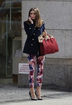 Olivia Palermo rocks the floral pants with this military inspired blue blazer and fab red bag. Xo.