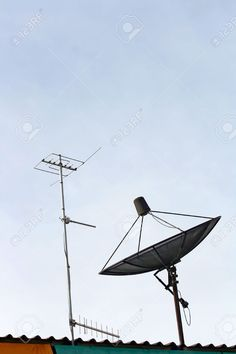 7669772-Satellite-dish-and-Radio-Antenna-on-the-house-Roof-Vertical-Stock-Photo.jpg (866×1300)