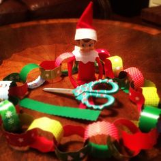 Elf on a Shelf - Antic: Showing his crafty side by making a Christmas Chain Wreath