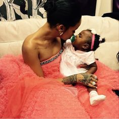 12 photos that prove that Rihanna is actually the ultimate babysitter.