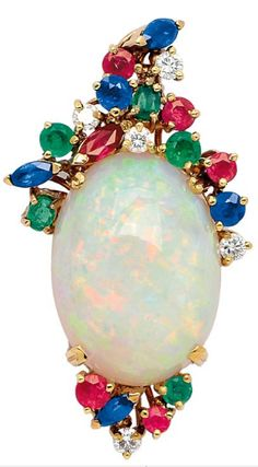 Opal, Gem-Set and 18K Gold Pendant  The oval opal measuring 19.5 mm by 14.5 mm by 7.9 mm, amid diamonds, rubies, sapphires and emeralds
