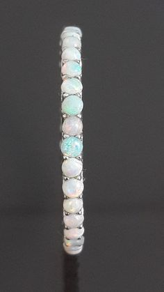 9ct white gold opal eternity band by IsaBellaJewellery on Etsy
