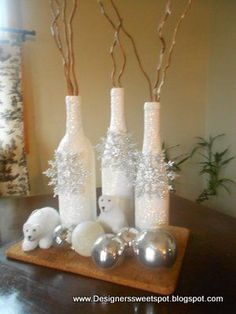 Decorative Bottles :     Cover Wine bottles with glue and roll in Epsom Salts. Decorate with snowflake ornaments…    -Read More –   - #DecorativeBottles https://decorobject.com/decorative-objects/decorative-bottles/decorative-bottles-cover-wine-bottles-with-glue-and-roll-in-epsom-salts-decorate-with-snowflake-or/