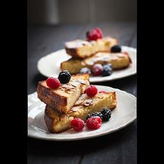 Almond Toasted Brioche | Almond brioche (brioche filled with almond paste) is a Parisian breakfast staple. In her adaptation, Grace Parisi soaks store-bought brioche in almond-infused custard—almost as if she were making French toast—and bakes it until crisp. It's lovely sprinkled with confectioners' sugar and topped with berries.