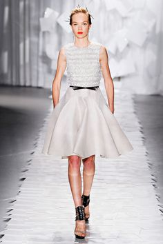 Jason Wu: Spring 2012 Ready to Wear -- Every one of his pretty and precious Wu-isms all present and correct—delicate lace, sparkling embroideries, fluttery feathers galore. -- Vogue