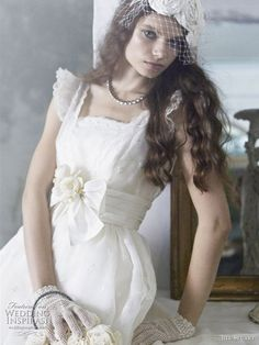 Bird cage veil and ruffle sleeve wedding dress with bow detail and short net mesh gloves