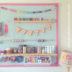 DIY Craft Room: How to Make Your Own Jumbo Framed Pegboard Wall. Pretty and so organized! As featured on GoodHousekeeping.com!