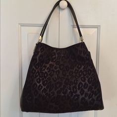 Coach Madison Small Phoebe Ocelot RARE This GORGEOUS Bag is a very RARE Coach Shoulder bag that could be called NEW since it is absolutely PERFECT. I carried it one time only.  It's the Madison Small Phoebe Ocelot Shoulder Bag that is Black Leather and Chenille.  It has ZERO defects and no signs of use at all.  Comes with Dustbag.  I also have a matching Scarf and Phone Case on separate listings.  Any questions, please ask. Sorry, no trades PRICE IS FIRM.  Sorry, will not entertain lowball…