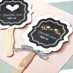 Place these adorable paddle fans custom printed with a wedding design, the bride and groom's name and wedding date in decorative tins or baskets near the entrance to your wedding ceremony. Your ring bearer and flower girl can also hand fans out to guests as they arrive so they can stay cool during your summer wedding. These fans can be ordered at http://myweddingreceptionideas.com/personalized_chalkboard_wedding_paddle_hand_fans.asp