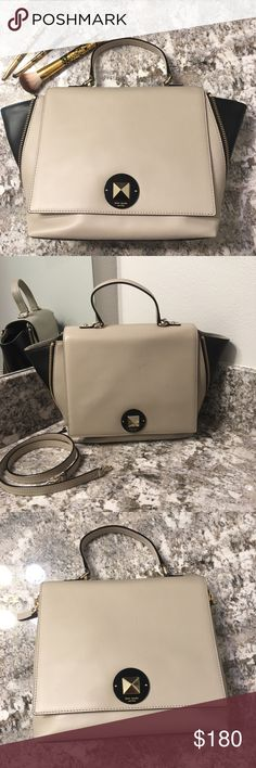 Kate Spade Varick Street Abbie Color block Satchel This is a medium sized all leather satchel.  It's a versatile purse as it can be used in different forms (see pictures).  It consists of black and taupe/gray colors.  Item is in great condition with no wear on its corners, top handle or longer crossbody strap.  It does have a few minor flaws.  Minor scratches on the twist closure lock and a small knick as seen in my last photo.  Other than that it's a great purse and it's very clean…