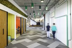 Cisco Offices / Studio O+A. parquet carpet layout, exposed light wiring, collaborative rooms