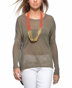 Central Park West High-Low Sweater.        Comfy shear sweater with a pop out necklace