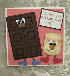 S'MORE Love. The marshmallow top is the Large oval punch. The shoes and eyes are the heart to heart punch. The chocolate bar is just one square punch inside another. The chocolate bar nose is a shortened word window.