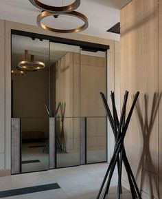 Contemporary Entry - minimalist millwork, mirrored doors and sleek lighting. Office Interior Design, Interior Design Living Room, Interior Decorating, Home Luxury, Luxury Interior, Wood Interiors, Office Interiors, Design Hotel, Interior Wood Shutters