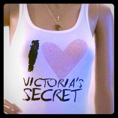 NWT Victoria's Secret white tank size Large NWT is this beautiful tank with rhinestones by Victoria's Secret . 1 stone is missing but you can barely see it.. Shown in the pictures. Victoria's Secret Tops Tank Tops