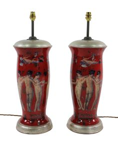 A pair of declamania hand painted table lamps depicting Pompeian scenes. With white gold leaf tops and bases. Measures: 63cm high x 20cm diameter   Stock Code MP0323