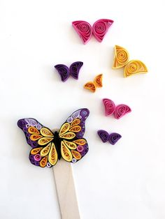 Bookmark butterfly, a wooden stick, whose end part is decorated in paper, with quilling technique (an ancient technique that consists in rolling thin . Paper Quilling Earrings, Paper Quilling Cards, Paper Quilling Flowers, Paper Quilling Patterns, Quilled Paper Art, Quilling Butterfly, Quilling Work, Quilling Craft, Quilling Ideas