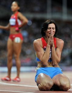 Russia's Natalya Antyukh wins the gold in the 400m hurdles
