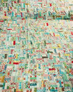 """Kim Ripley: """"sooooo happy to have inherited this enormous hand-stitched quilt!  My sister and I used to sleep with this quilt when we spent the night at our grandma's. We used to spend so much time just staring at it and looking at all of the different pieces. It is really an amazing piece to see in-person. This was made by my great-grandma and it is a queen-sized blanket."""