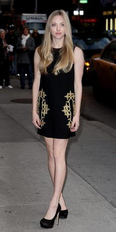 AMANDA SEYFRIED - Michael Kors black tricotine shift with gold passementerie from the Resort 2013 Collection