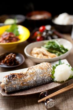 Japanese meal - grilled fish (ayu?) with daikon