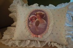 Lovely image of mother and daughter taken from a vintage German post card.  Pillow from Etsy shop.