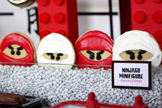"""Kick up your LEGO Ninjago party supplies with 23 of the best Ninjago birthday party ideas! Pack a punch with these Ninjago party decorations. Entertain guests with games like """"pin the mask on the ninja"""" or Lego Ninjago, Ninjago Party, Ninja Birthday Parties, Birthday Ideas, Lego Parties, 8th Birthday, Chinese Party, Birthday Cookies, Legos"""