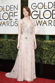 Cov Editors Share Their 2017 Golden Globes Red Carpet Favorites: In between champagne breaks, we summed up our favorites in a game of superlatives that's basically a throwback to our high school yearbook days. — Emma Stone in a pale pink Valentino gown with siver star detailing    coveteur.com