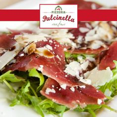 Italiana - Slices of bresaola served with parmesan shavings on a bed of rocket with a drizzle or olive oil and vinegar. pulcinelladubai.com | 800 PIZZERIA ‪#‎italianPizza‬ ‪#‎food‬