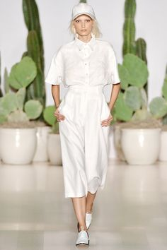 The @marahoffman show for #NYFW #MBFW #SS15 opened with a flash of bright white in sporty culottes and an embroidered button down.