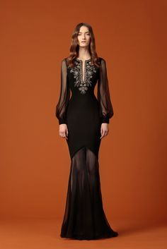 Andrew Gn Pre-Fall 2015 - Look 35 - Hourglass-shaped black formal gown with sheer skirt and sleeves gathered at the cuff (bishop sleeves), tulip shaped upper skirt, and embroidery at slit neckline