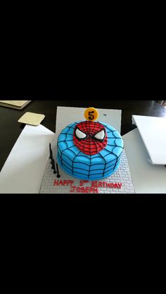 Spiderman head cake with web background