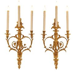 A pair of French mid 19th century Louis XVI st. ormolu three arm sconces | From a unique collection of antique and modern wall lights and sconces at https://www.1stdibs.com/furniture/lighting/sconces-wall-lights/