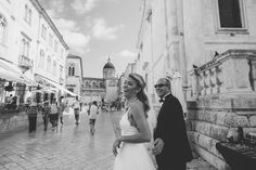 Dubrovnik wedding.  Bride and her father walking to the Cathedral in Dubrovnik.