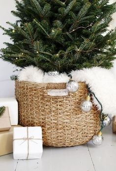 Simple Christmas Tree Display Modern Christmas Tree Display The Merrythought Scandinavian Christmas Decorations, Decoration Christmas, Noel Christmas, Xmas Decorations, Winter Christmas, Christmas Crafts, Christmas Tree Ideas For Small Spaces, Nordic Christmas, Christmas Tree In Basket