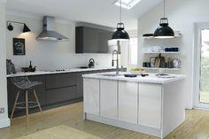 Wren kitchen. Grey gloss handleless doors, white island, grey quartz counter top, antique white wals, oak floor.