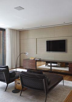 dark chairs, tan wall, walnut ? media center Tempo House / Gisele Taranto Arquitetura