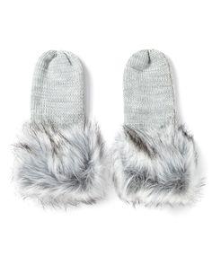Complétez votre tenue extérieure avec ces jolies mitaines! En plus de tenir vos mains au chaud, elles donneront du style à votre look grâce à leur garniture en fausse fourrure. Idéales pour la saison froide!