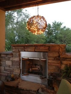 One ball of barbed wire + two strings of Christmas lights = A pretty cool outdoor chandelier.