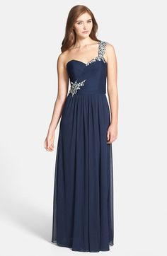 Free shipping and returns on Xscape Beaded One-Shoulder Sheer Jersey Gown at Nordstrom.com. Set against sheer navy jersey, iridescent crystals and beads glitter atop the single shoulder and bloom from the opposite side of a finely shirred sweetheart-neckline bodice beginning a graceful full-length gown.