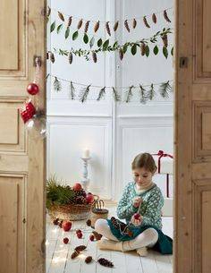 Des guirlandes de pommes de pin pour Noël