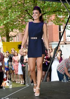 Kym Marsh flaunts her toned legs in a tiny mini dress #dailymail