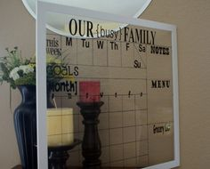 The perfect way to organize your family- A glass frame with calendar and list space that you can use as a dry-erase board.
