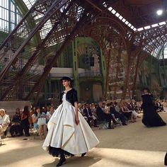 #CoutureWeek Under a replica of the Eiffel Tower Chanel showcased a collection that transformed from daywear featuring heavy tweeds and rounded shoulders to eveningwear featuring 3D florals feathers and full skirts. #高定周 #香奈儿 将埃菲尔铁塔带入巴黎大皇宫在铁塔下展示了一个由花呢日装与席地裙摆晚装组成的系列  via VOGUE CHINA MAGAZINE OFFICIAL INSTAGRAM - Fashion Campaigns  Haute Couture  Advertising  Editorial Photography  Magazine Cover Designs  Supermodels  Runway Models