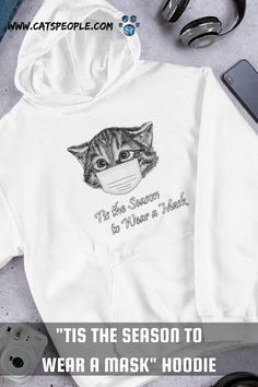 The purrfect hoodie for 2021 christmas. With a cute kitten wearing a mask design and a funny and meaningful message, this hoodie will be every cat parent's favourite this christmas! For cat moms and cat dads with a sense of humor, get this hoodie to welcome the upcoming special christmas and keep as a reminder of the special times we're living in! #catloverhoodie #catmomhoodie #catdadhoodie #christmashoodie #christmascathoodie #christmasgift #maskedkitten #2021christmas