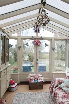 Glassed in Room - sort of like a little Conservatory!! Neat Idea!!