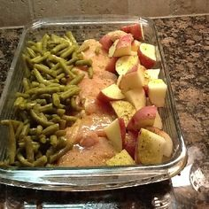 4-6 raw chicken breasts, new potatoes, green beans (fresh or canned-really any green veggie would work. Broccoli is good, too). Arrange in 9×13 dish. Sprinkle with a packet of Italian dressing mix and then top with a melted stick of butter. Cover with foil and bake at 350 degrees for 1 hour.