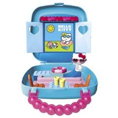 Hello Kitty fans will love this pool party small case set. Includes 19 pieces such as a collectible Hello Kitty figurine with sunglasses, floaty ring, carrying case, buildable table, chairs, pool, slide, diving board and more.